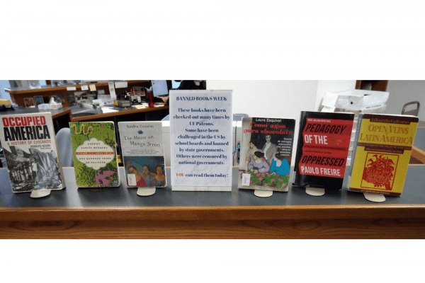 Display of books at library circulation desk with a graphic for